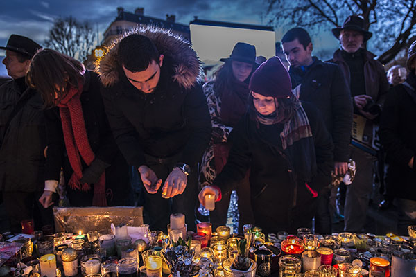 Tributes are left for victims of a terror attack. Image: iStock.